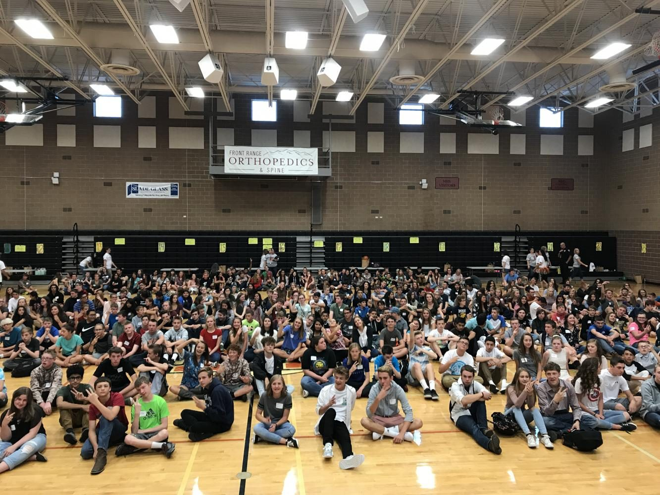 Class of 2021 poses in the main gym on their first day of school, as Posse leaders prepare them for their high school journey.