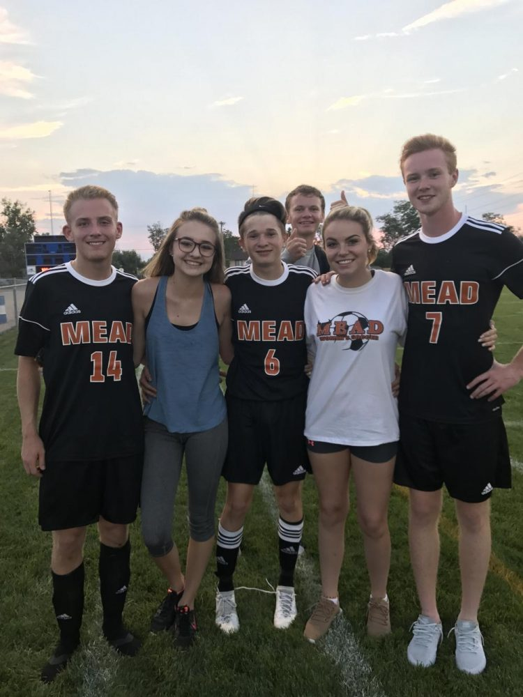 Senior varsity players Marcus Allen, Tristan Anton, and Connor McCawley pose with Editors Paige Reorda and Kelly Shields, after winning Monday nights preseason scrimmage 3-1; as senior manager Zack Collins joins in on the fun.