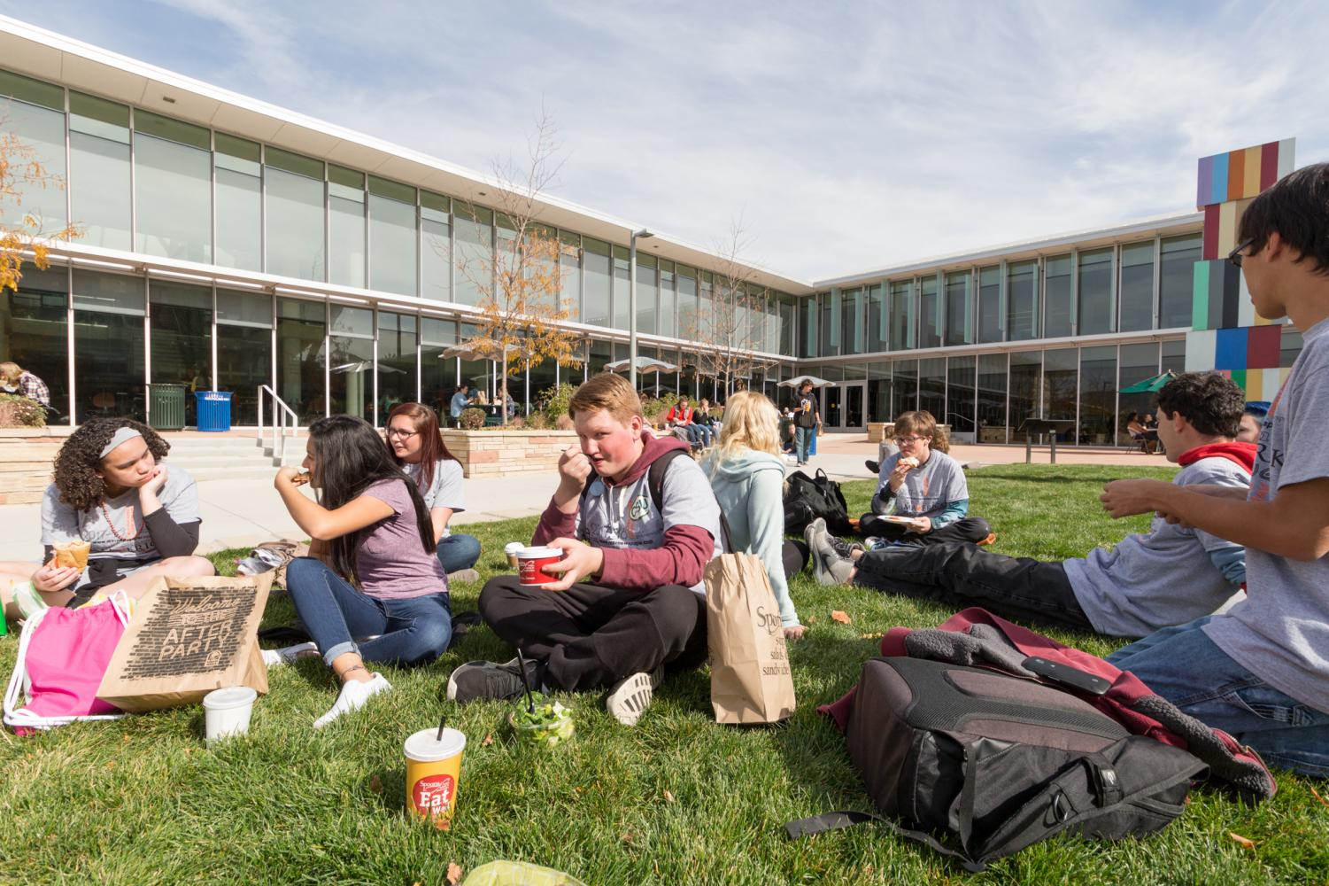 Students of The-MAV enjoy lunch on a nice fall day.