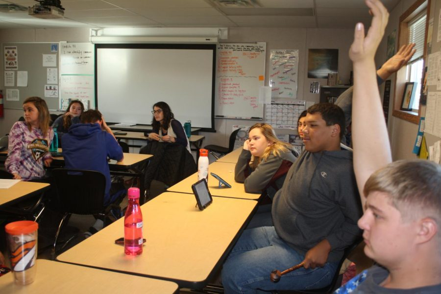Students are eager to respond to the current event discussion.