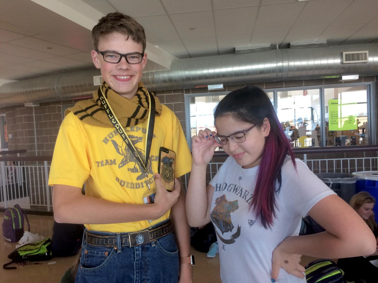 Sophomores Aiden Owen and Brandi Tracy pose wearing their Harry Potter merchandise.