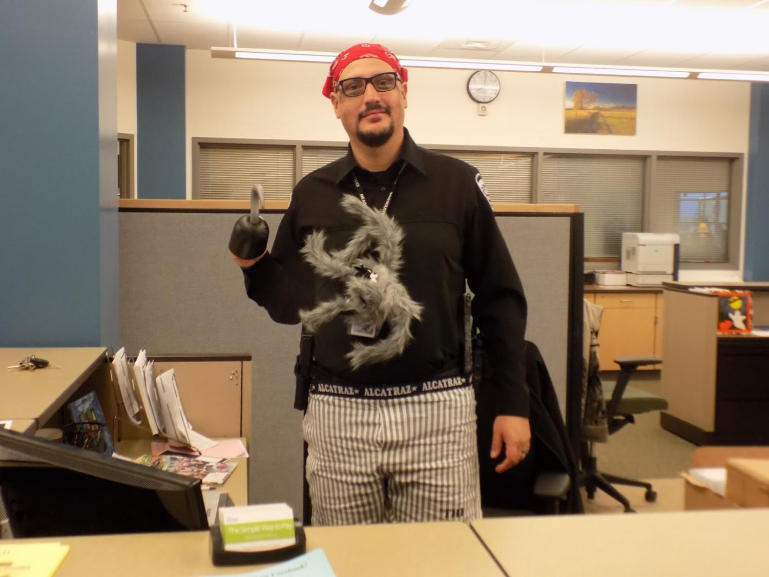 SRO Officer Ish shows off his pirate costume in the main office on Tuesday