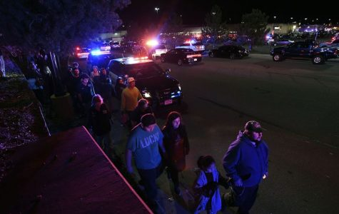 Employees and shoppers are released from a holding area in Walmart lot in Thornton on Nov. 1.