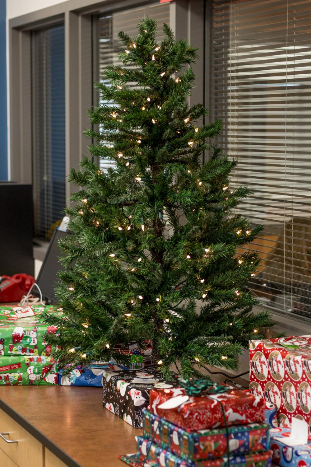 Present lie underneath the Giving Tree in the office.