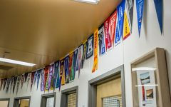 A string of banners representing various colleges lines the counseling office.
