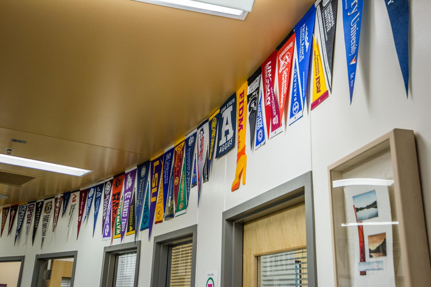 Banners from colleges who have visited MHS, or have been attended by MHS staff members.