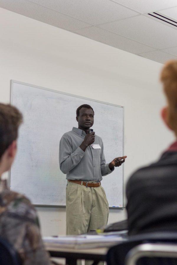 Arok Garang explains his story to Integrated 9 students