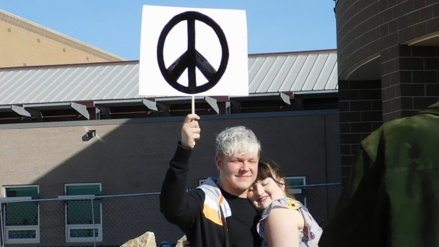 Seniors Tyler Prigmore and Mikayla Boldt stand together for peace