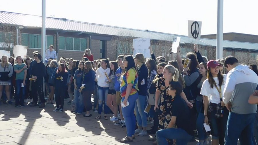 Students gather to listen to others speak out against violence