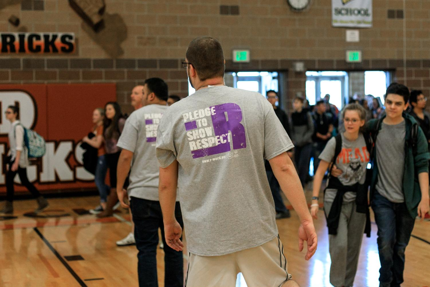 Band teacher, Mr. Kirkwood, wears the new Spread the Word to End the Word t- shirts during Unified Game
