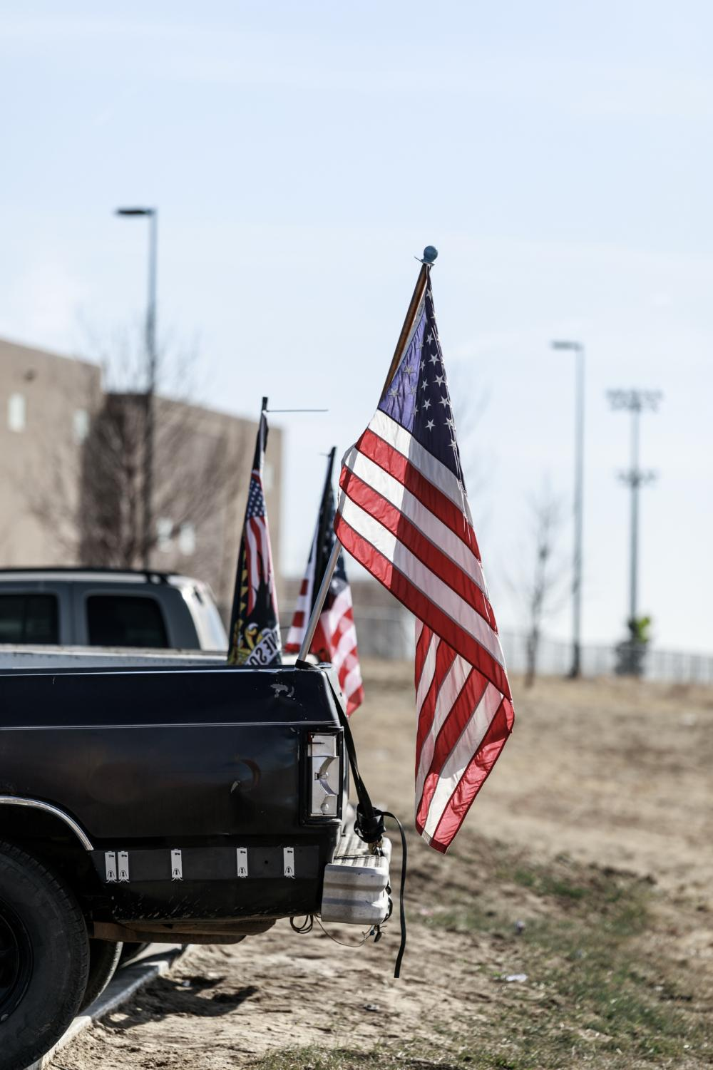 In+response+to+the+walkout%2C+several+students+display+their+American+flags.+