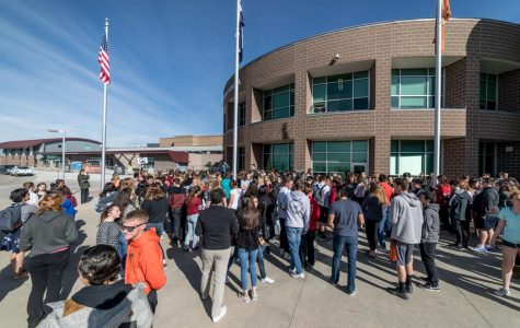 Students watch from the window as peers walk out in memory of Parkland shooting