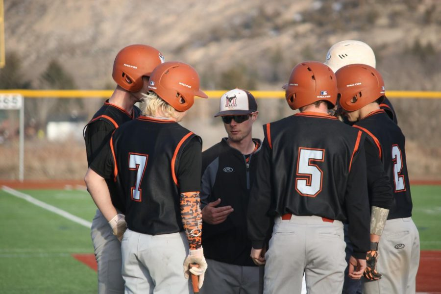 Coach Click holding team huddle-Photo courtesy of Trudi Boaz