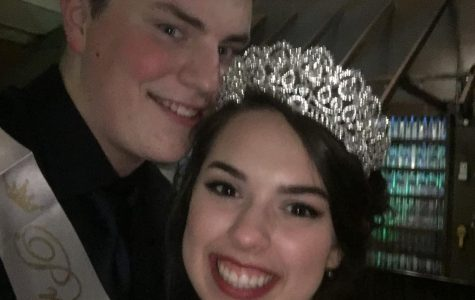 Big smiles from prom King and Queen while wearing their sashes.