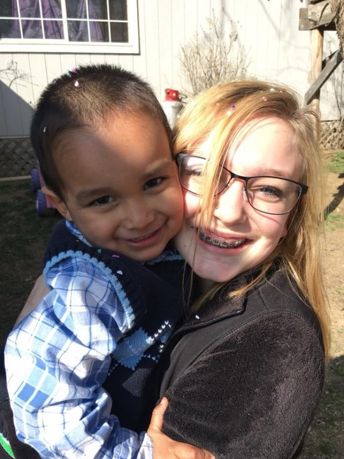 Student reporter Kassidy Trembath poses with her brother at an Easter celebration