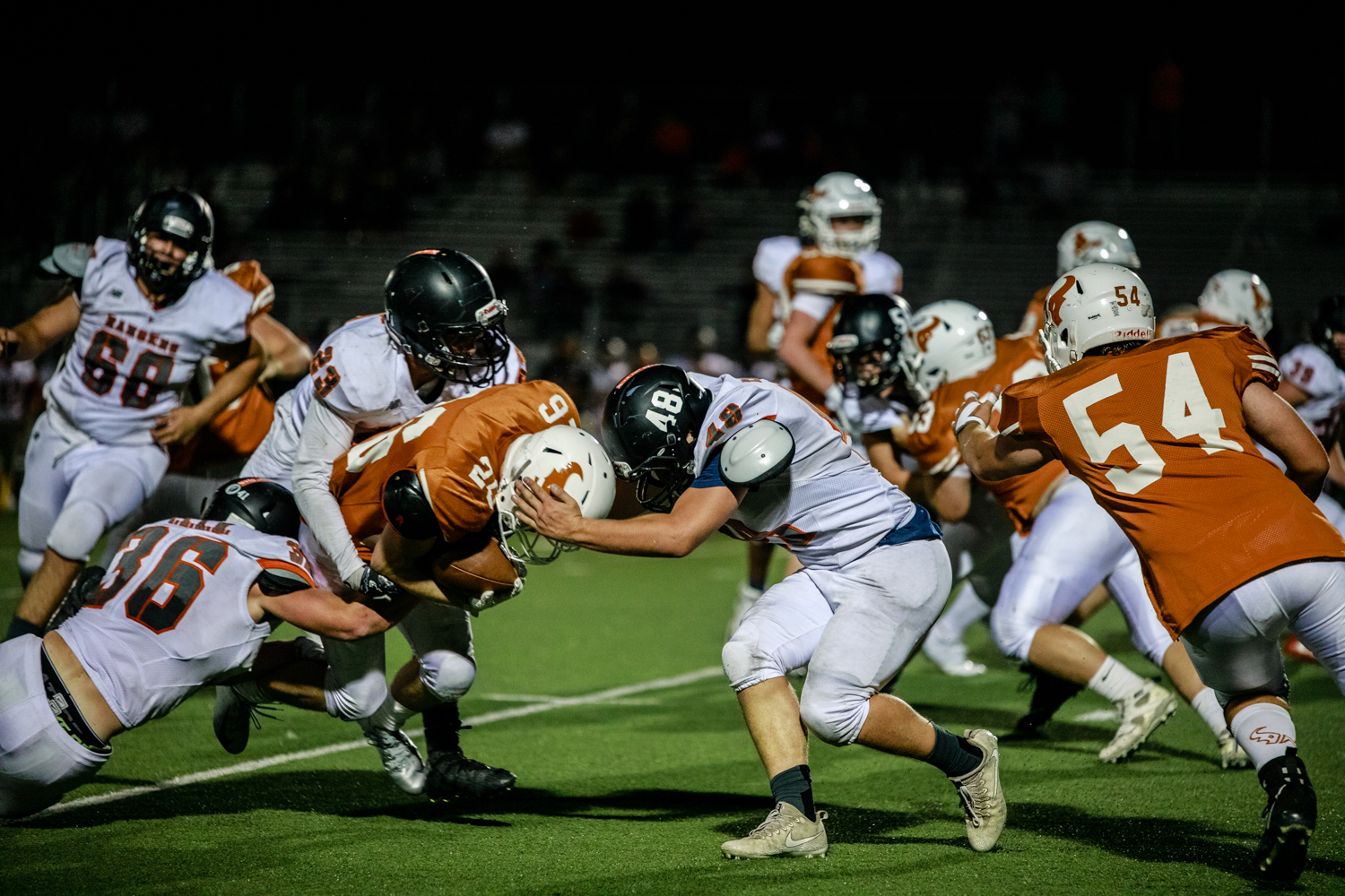 Running+back+%2326+Nathan+Bailey+fights+off+3+defenders+to+put+the+Mavs+in+scoring+distance.