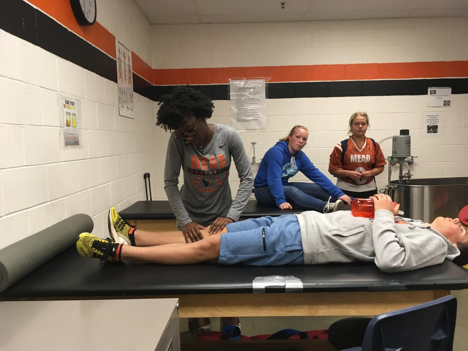 A student undergoes a physical evaluation.