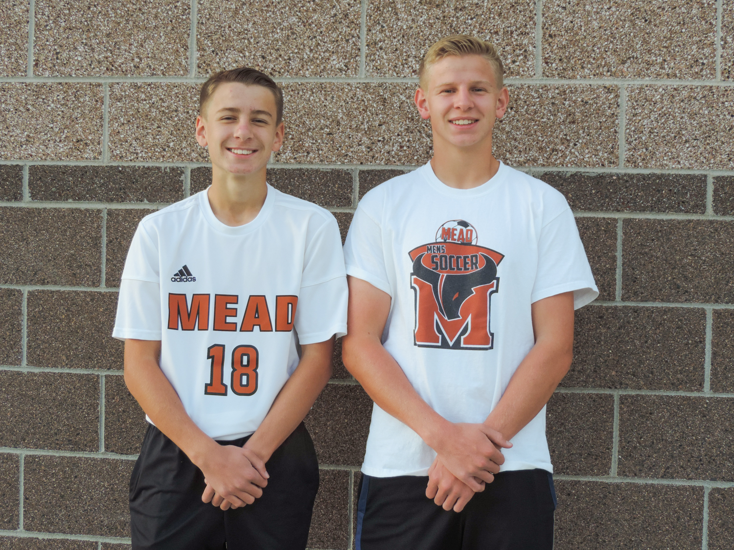 Wyatt and Winston Sears, two brothers on the Varsity Soccer team, showing their pride in their team here at Mead by wearing their favorite Mav gear.