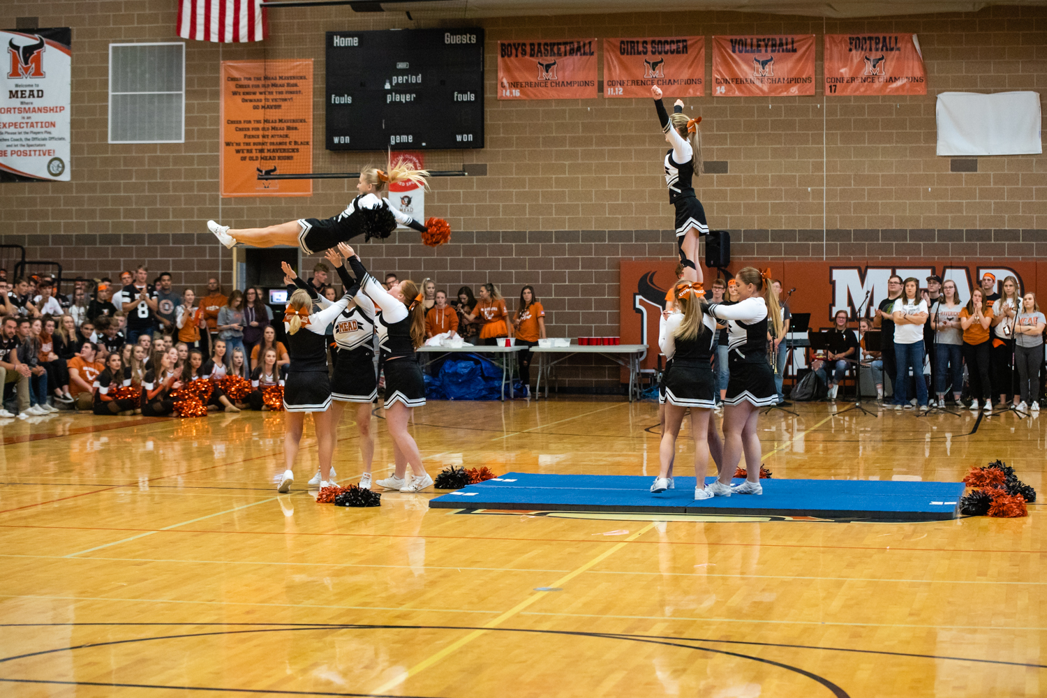 Cheer+ends+their+routine+with+spectacular+ariels+facing+the+upperclassmen.
