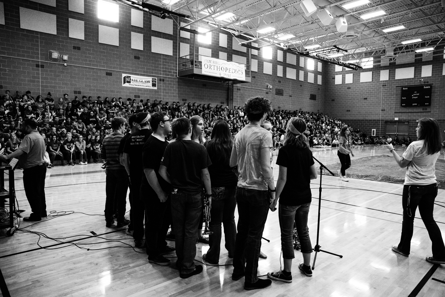 Jazz+Choir+performs+their+second+song+with+the+Jazz+band+in+front+of+the+student+body.++