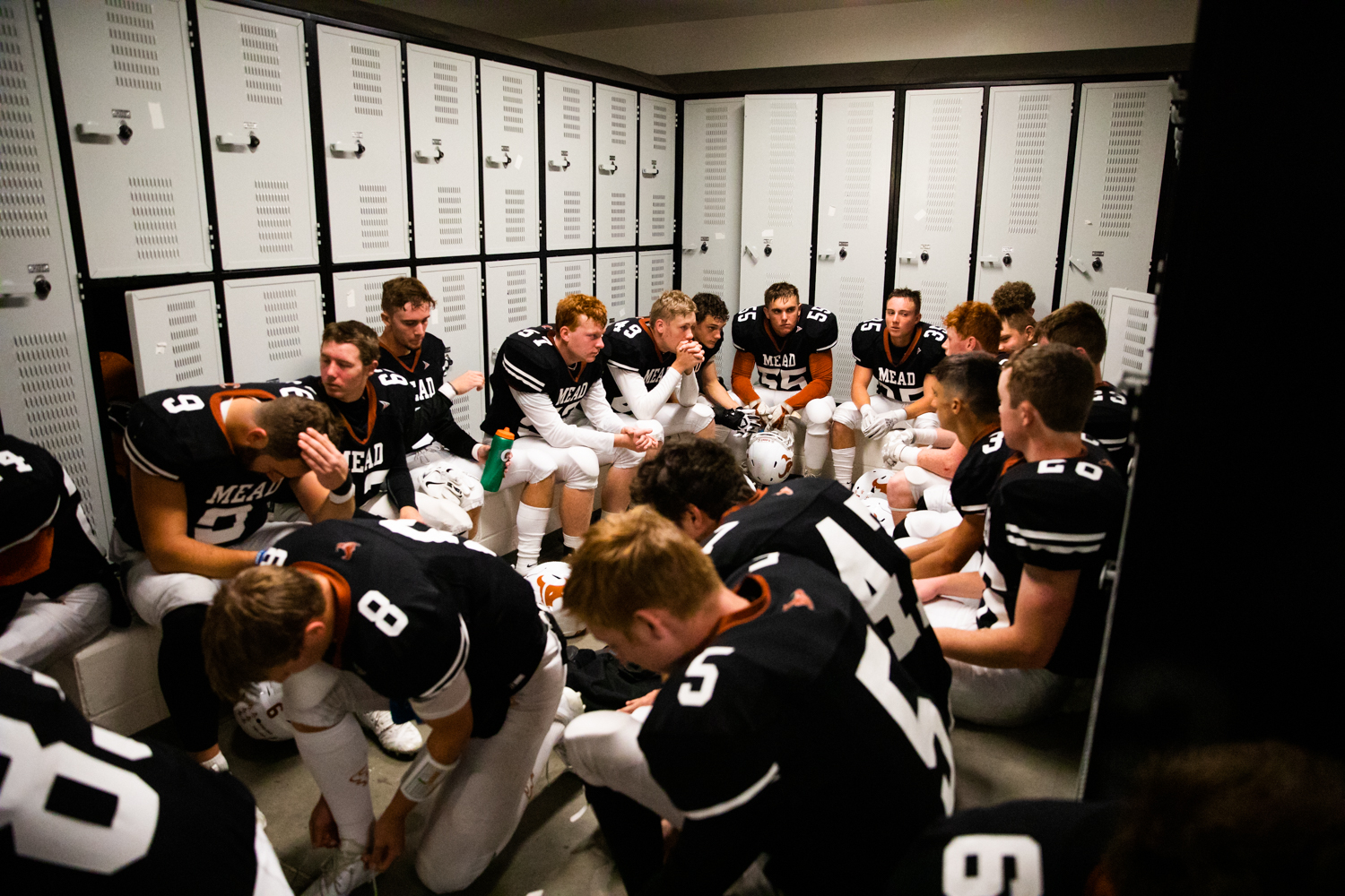 Players+from+the+football+team+wait+inside+the+locker+room+before+the+game.