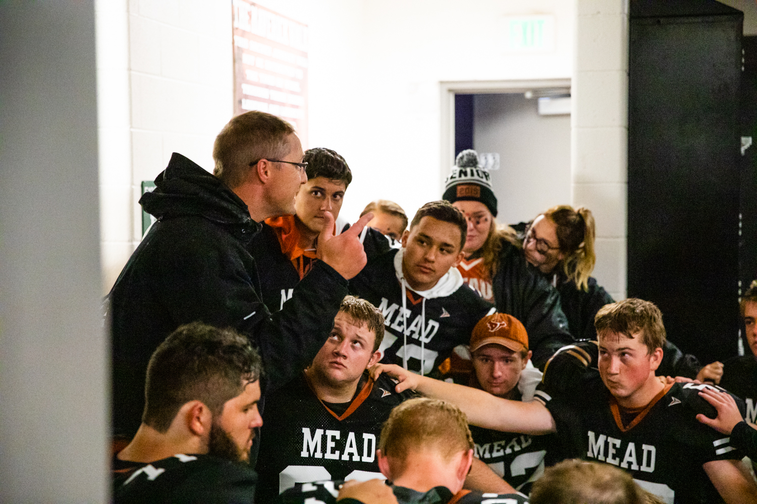 Coach+Klatt+gives+a+pep+talk+to+the+assembled+team+before+they+head+out+to+the+field.