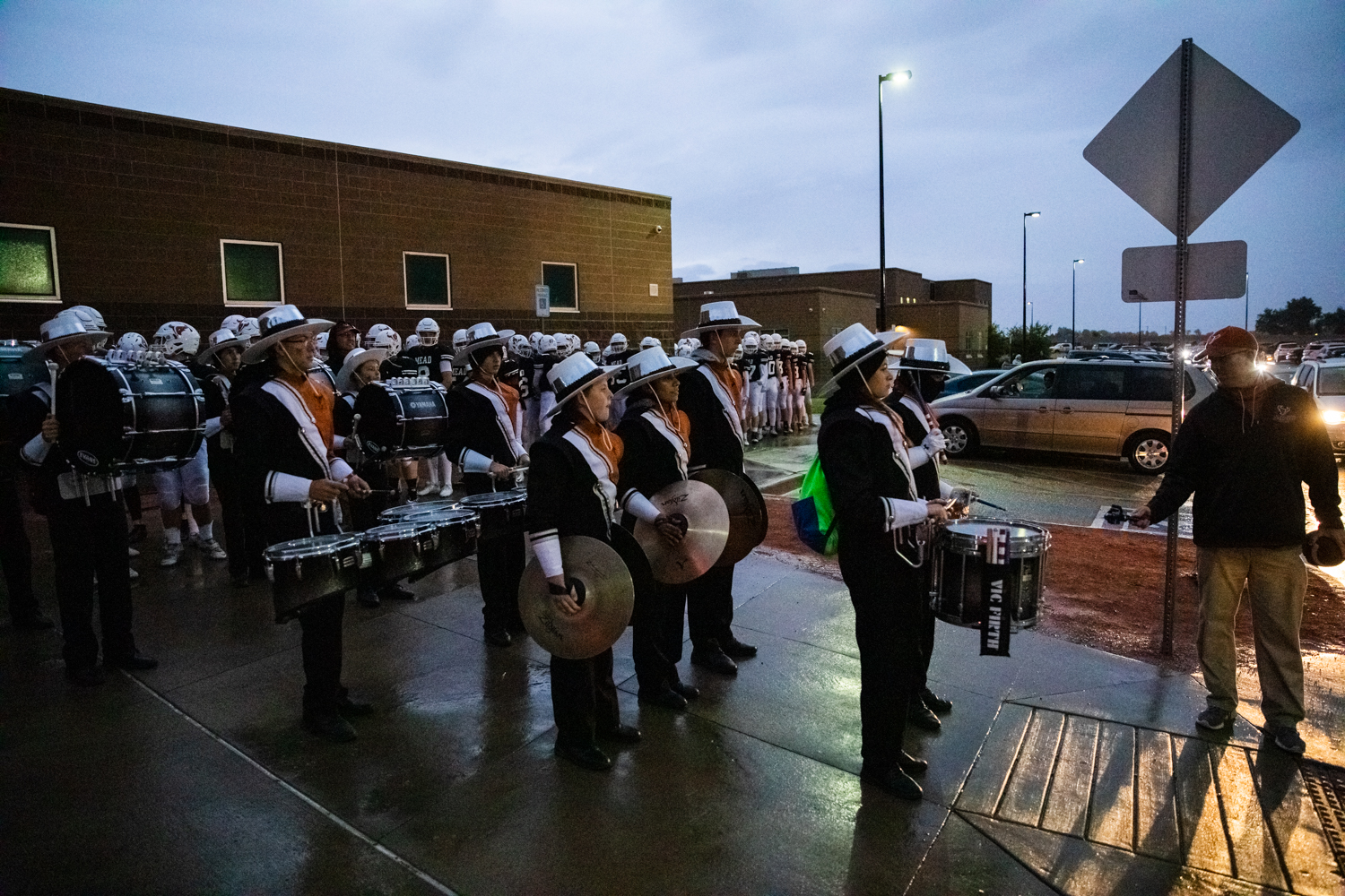 Even+through+the+rain+the+drumline+leads+the+football+team+down+to+the+field.+The+rest+of+the+band+was+not+able+to+play+due+to+the+rain+though.+The+moisture+is+terrible+for+the+instruments.