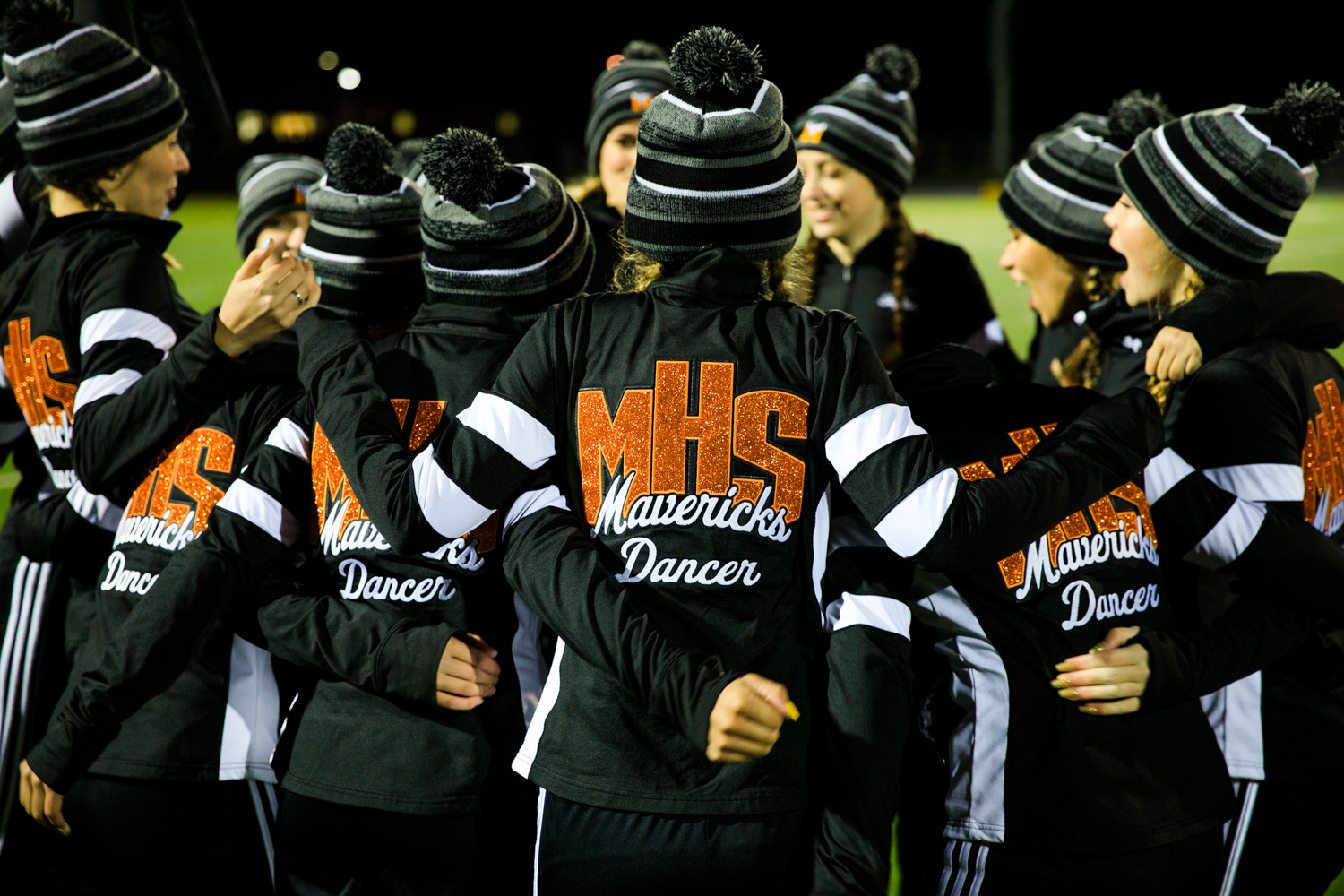 The+dance+team+huddles+up+before+their+halftime+performance.