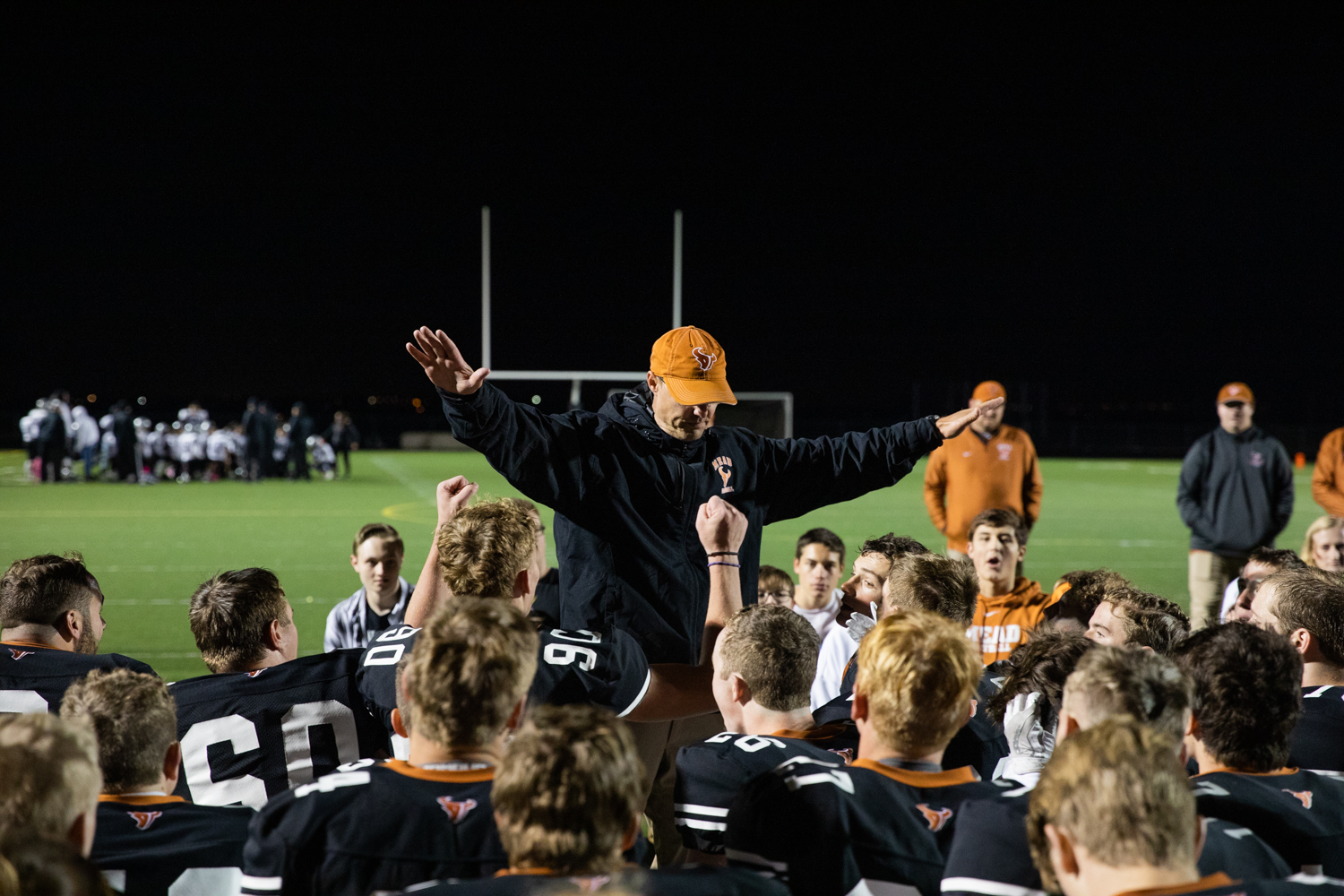 Coach+Klatt+silences+the+crowd+to+address+them+after+the+win.+In+the+background+Skyview+players+form+a+similar+crowd+around+their+coach.