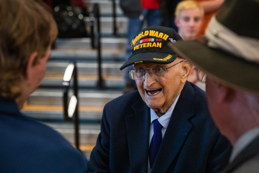 Tom+Meylor%2C+a+World+War+II+veteran%2C+is+greeted+by+those+in+attendance+at+the+Veterans+Day+assembly.