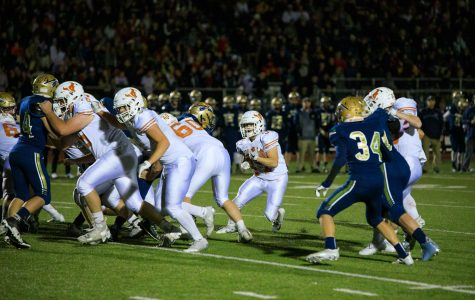 Varsity Football crushes cross-town rival Frederick 30-8 in 9News Game of the Week and secures a home playoff game