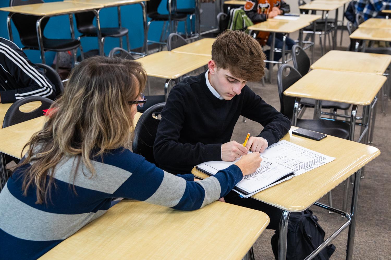 Junior Alex Mueller gets help with school work.
