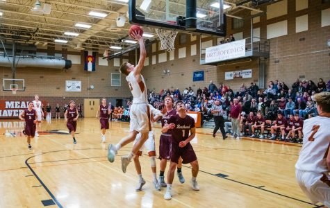 Varsity Boys Basketball string up their twelfth straight win