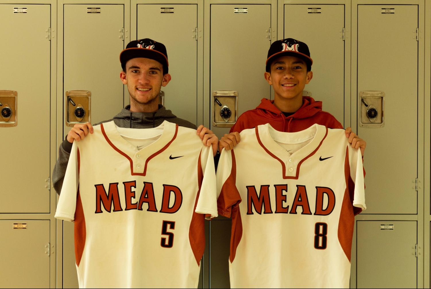 Players Jason  Torbeck and Jalen Martinez pose with their jerseys.