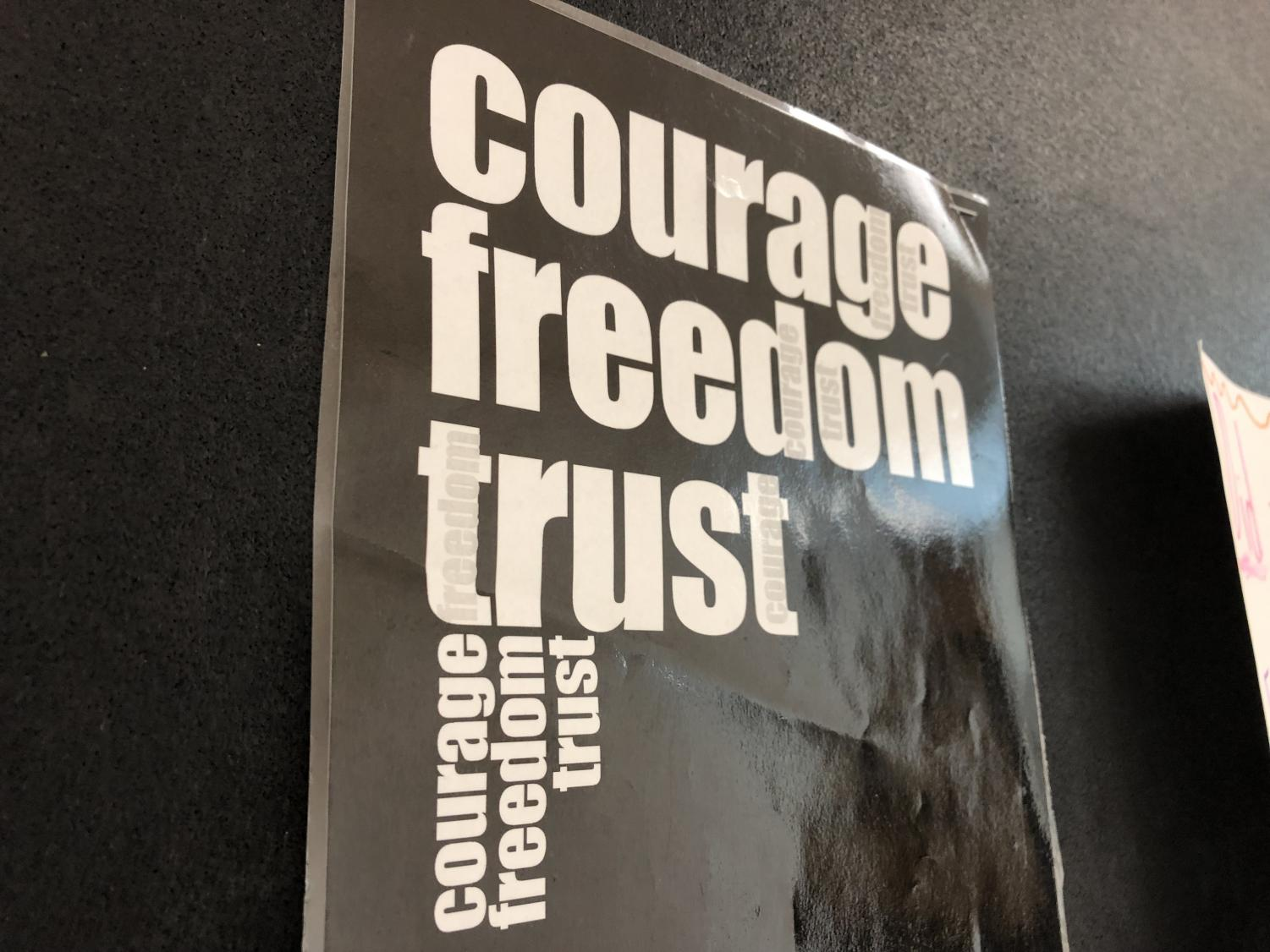 A poster hangs in the hallway of the D Wing encouraging freedom and trust.
