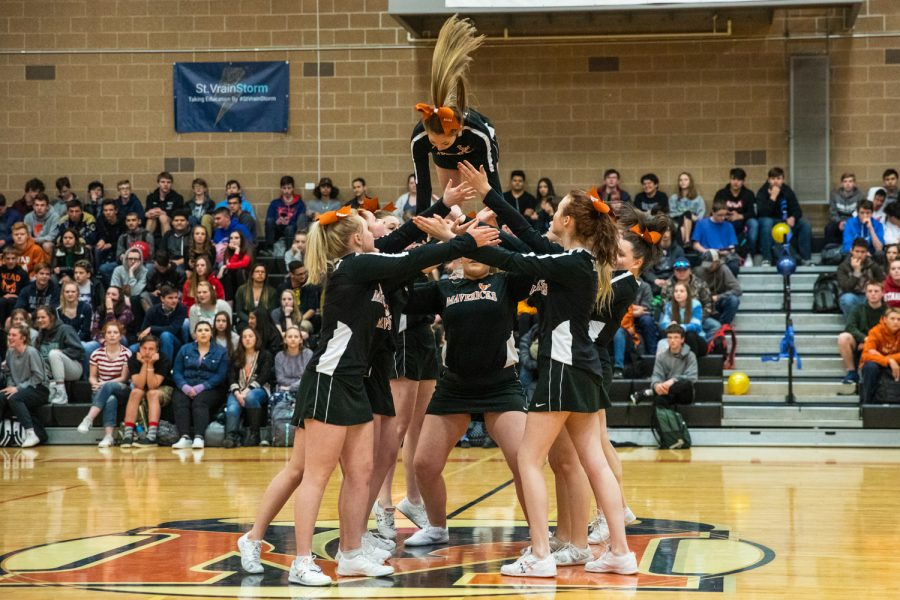 The Cheer Team catches their flier as she comes down