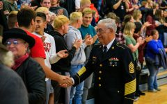 A veteran shakes hands with students of MHS.