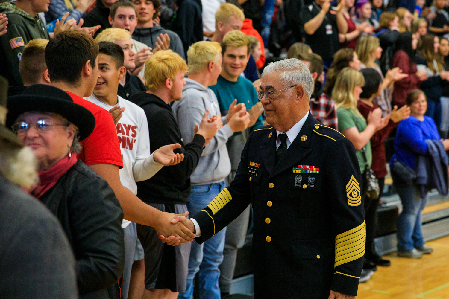 A veteran shakes hands with students of MHS