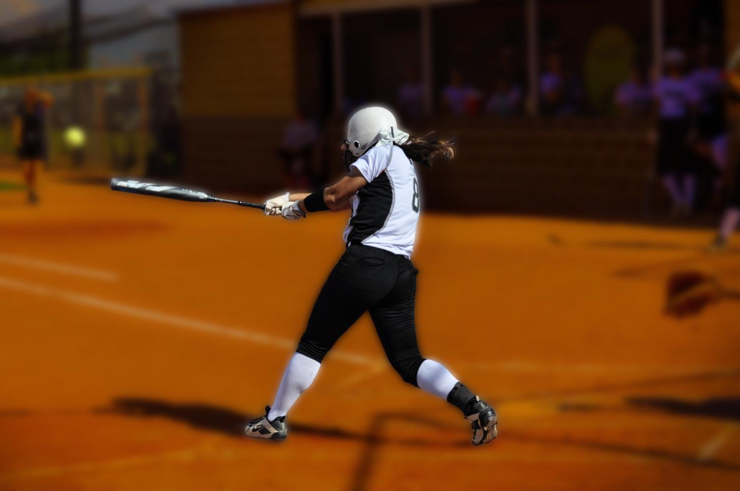 Junior Delaney Wilson, #8, drives in two runs on a triple in the first inning.