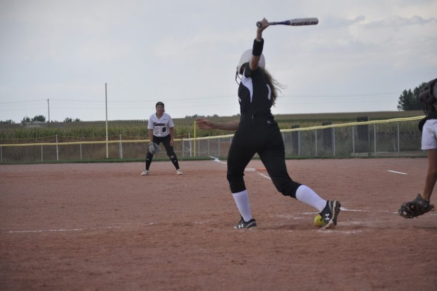 Elsa Burgesser ('22), #1, batting at home plate