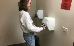 A happy Maverick uses a hand dryer in its best form