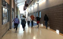 "A group of Freshmen students, acting as ""The Stompers"", running down the hall to the cafeteria."
