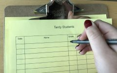 A student getting ready to sign the Tardy Sheet, trying to come up with an excuse for being late.
