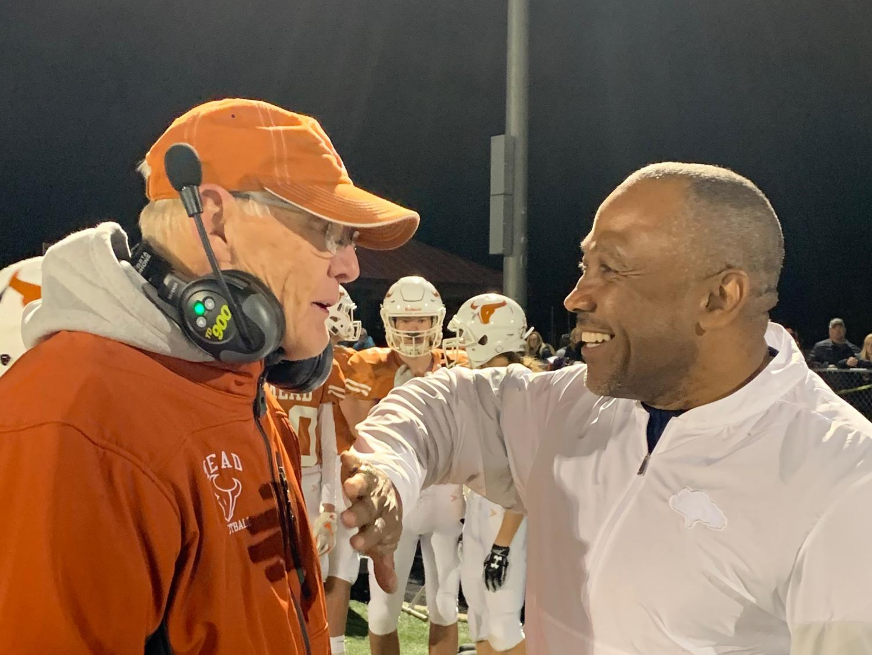 Gary Klatt Sr. (left) meets former Broncos receiver Mark Jackson during the Frederick game on 11/8.