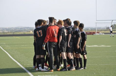 Boys soccer players huddling