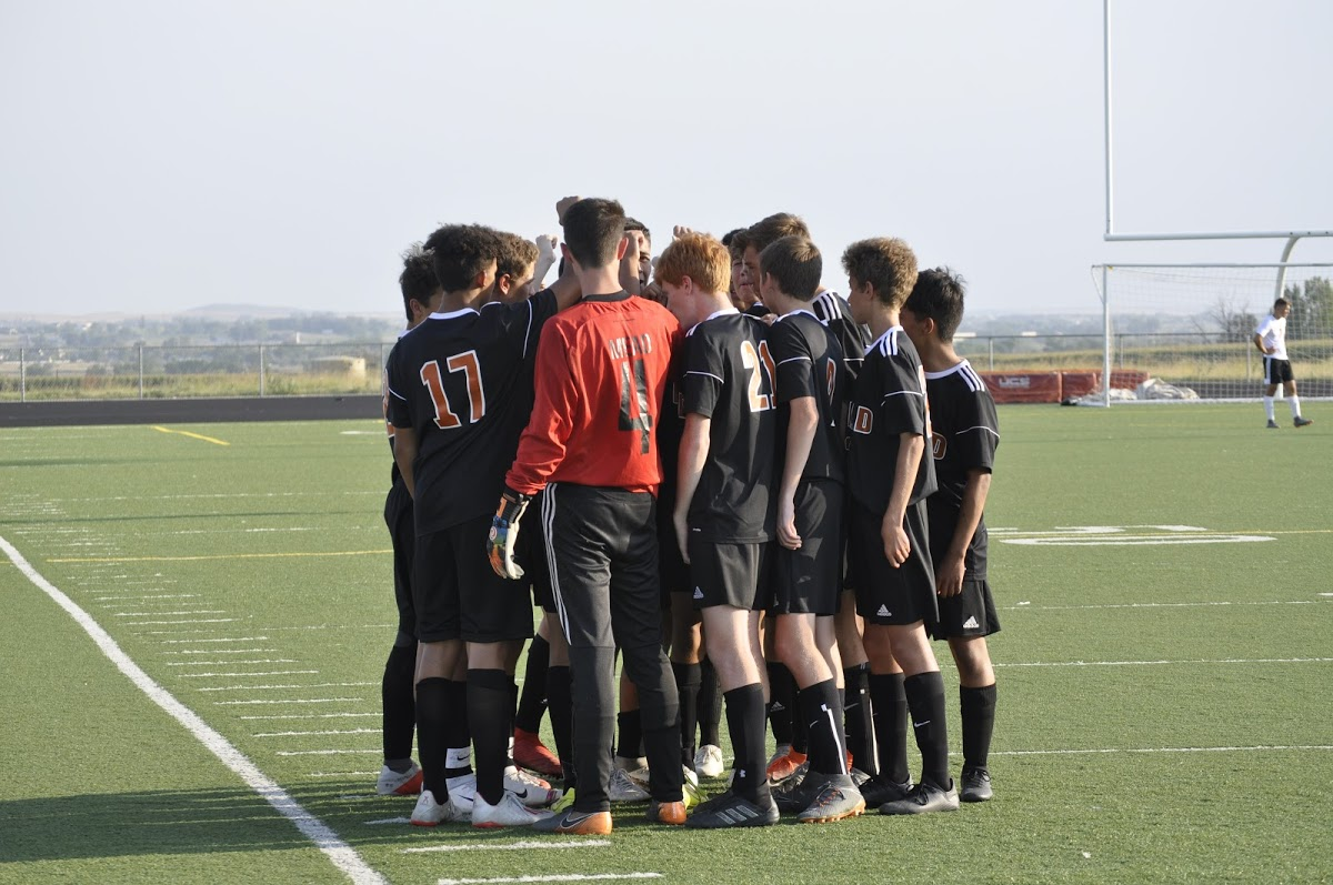 Boys soccer players huddling