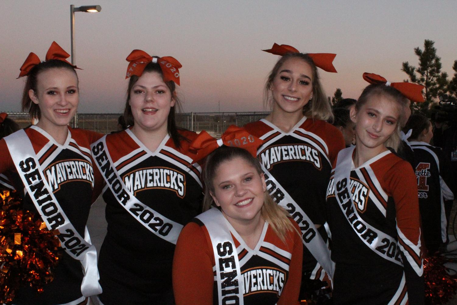 Senior+cheerleaders+pose+for+pregame+picture.