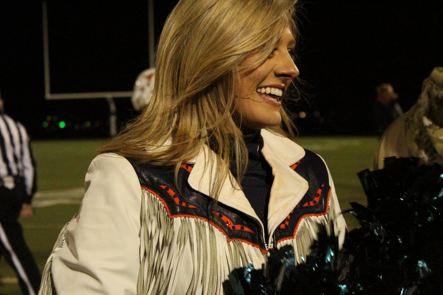 Broncos+cheerleader+walking+off+the+field+after+pre-game+show+at+Mead+High+School.
