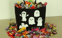 Candy overflows a Halloween bag.
