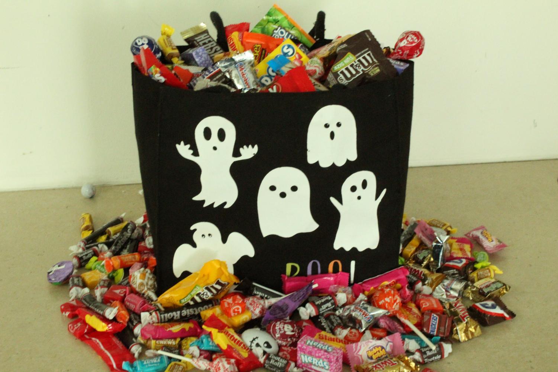 Candy overflows a Halloween bag.
